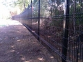 Custom fence walking trail connecting west memphis and memphis over harrahan railroad bridge