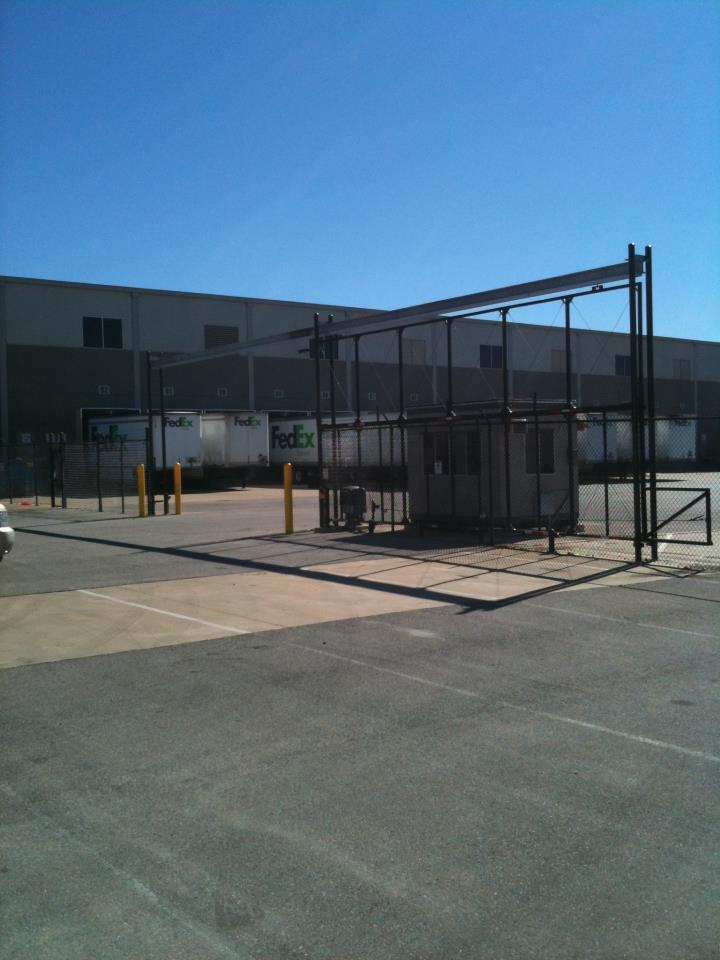 High Speed Overhead Truss Gates with Guard shack pipe bollards and high security operators
