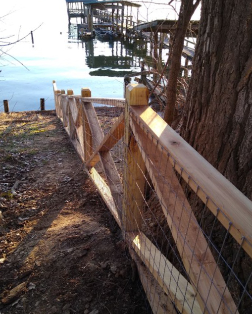 fence aending in a lake